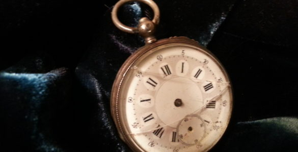 broken pocket watch with no hands